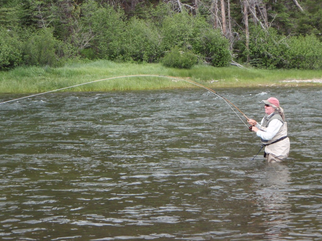 Check out the bend in the bamboo rod. There is nothing like feeling the fish all the way to the cork.